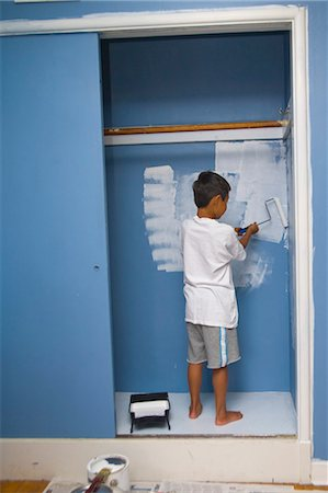 boy painting wall in closet Stock Photo - Premium Royalty-Free, Code: 673-03826316