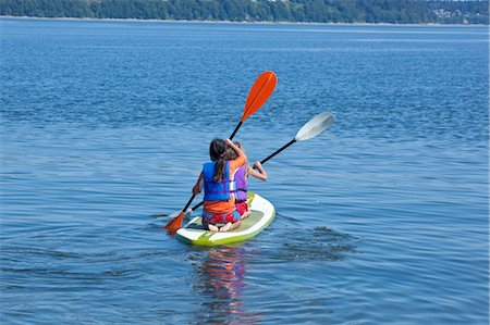 girls on paddle board in lake Stock Photo - Premium Royalty-Free, Code: 673-03826324