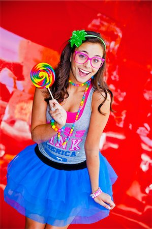 picture of a red lollipop - teen girl with large lollipop Stock Photo - Premium Royalty-Free, Code: 673-03826328