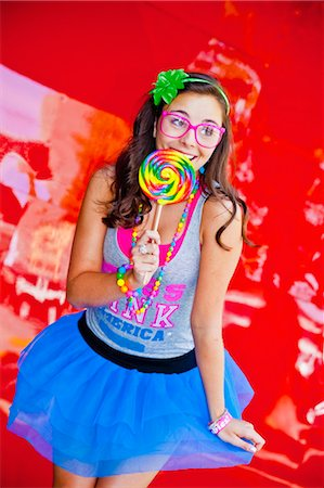 picture of a red lollipop - teen girl with large lollipop Stock Photo - Premium Royalty-Free, Code: 673-03826329