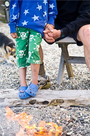 dog in heat - boy and man near beach fire Stock Photo - Premium Royalty-Free, Code: 673-03826356
