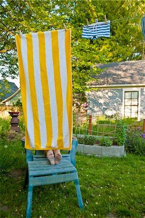 boy on garden chair under beach towel Stock Photo - Premium Royalty-Free, Code: 673-03826361