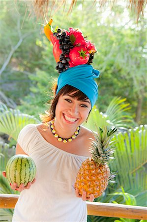 young woman wearing fruit hat Stock Photo - Premium Royalty-Free, Code: 673-03826456