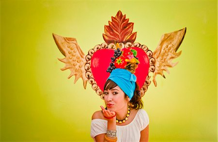 young woman wearing fruit hat Stock Photo - Premium Royalty-Free, Code: 673-03826469