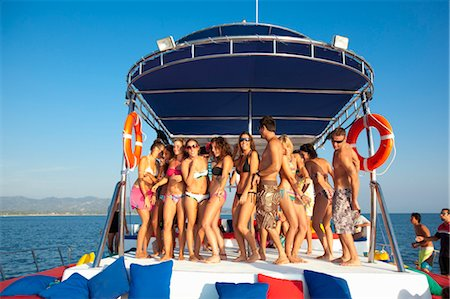 young people partying on yacht Stock Photo - Premium Royalty-Free, Code: 673-03826481