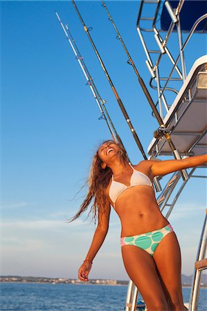 woman on ladder of yacht Stock Photo - Premium Royalty-Free, Code: 673-03826498