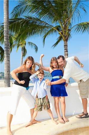 family posing as superheroes Stock Photo - Premium Royalty-Free, Code: 673-03826504