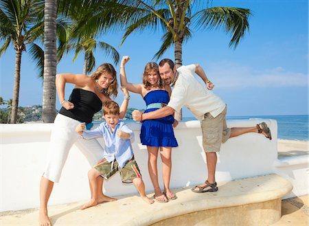 family posing as superheroes Stock Photo - Premium Royalty-Free, Code: 673-03826505