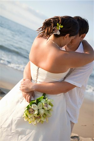special event - bridal couple hugging on beach Stock Photo - Premium Royalty-Free, Code: 673-03826525