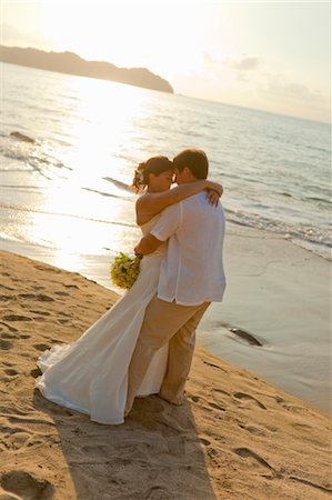 special event - bridal couple hugging on beach Stock Photo - Premium Royalty-Free, Code: 673-03826526