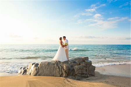 special event - bridal couple hugging on beach Stock Photo - Premium Royalty-Free, Code: 673-03826527