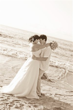 special event - bridal couple hugging on beach Stock Photo - Premium Royalty-Free, Code: 673-03826522