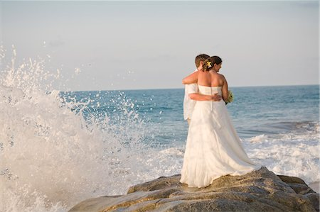 special event - bridal couple hugging on beach Stock Photo - Premium Royalty-Free, Code: 673-03826532