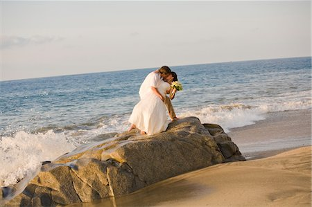 bridal couple hugging on beach Stock Photo - Premium Royalty-Free, Code: 673-03826533