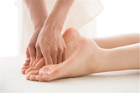 foot massage - Massage therapist applying foot massage Stock Photo - Premium Royalty-Free, Code: 685-02940845