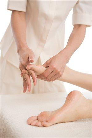 foot massage - Massage therapist applying foot massage Stock Photo - Premium Royalty-Free, Code: 685-02940846