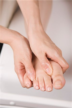 foot massage - Massage therapist applying foot massage Stock Photo - Premium Royalty-Free, Code: 685-02940902