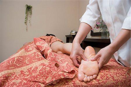 foot massage - Therapist massaging patient's foot Stock Photo - Premium Royalty-Free, Code: 685-02941919