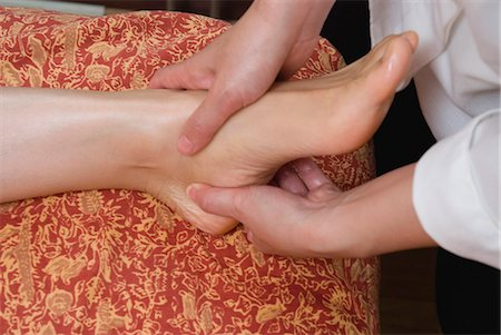 foot massage - Therapist massaging patient's foot Stock Photo - Premium Royalty-Free, Code: 685-02941920
