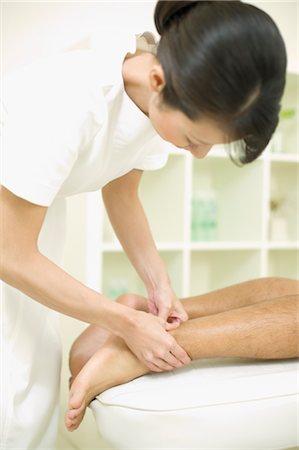 foot massage - Massage therapist applying foot massage Stock Photo - Premium Royalty-Free, Code: 685-03081826