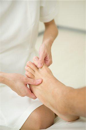 foot massage - Foot massage Stock Photo - Premium Royalty-Free, Code: 685-03081856