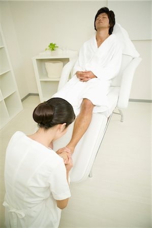 foot massage - Young man receiving foot massage Stock Photo - Premium Royalty-Free, Code: 685-03081851