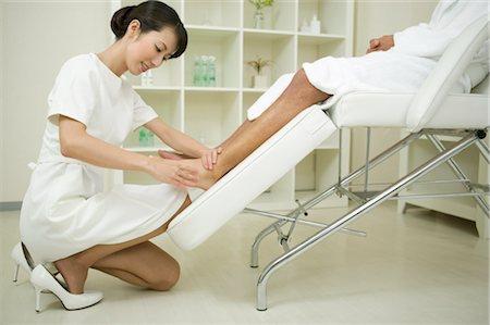 foot massage - Massage therapist applying foot massage Stock Photo - Premium Royalty-Free, Code: 685-03081852