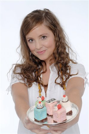Young woman holding confectionary Stock Photo - Premium Royalty-Free, Code: 689-05610137