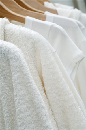 dangling - Bathrobes hanging on clothes hangers Stock Photo - Premium Royalty-Free, Code: 689-05610155