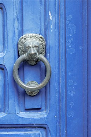 Blue door with door knocker Stock Photo - Premium Royalty-Free, Code: 689-05610340