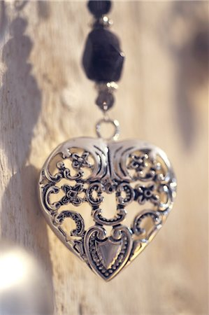 Necklace with heart-shaped pendant Stock Photo - Premium Royalty-Free, Code: 689-05610559