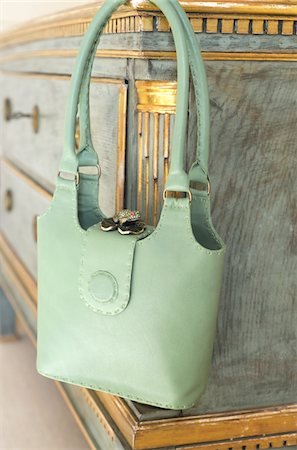 Green handbag hanging at sideboard Stock Photo - Premium Royalty-Free, Code: 689-05610678