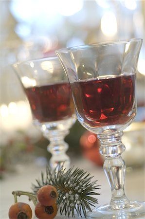 Two glasses of red wine and twig with fruits Stock Photo - Premium Royalty-Free, Code: 689-05610749