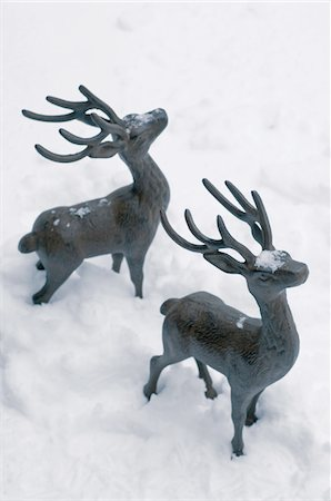 reindeer in snow - Two deer figurines in snow Stock Photo - Premium Royalty-Free, Code: 689-05610763