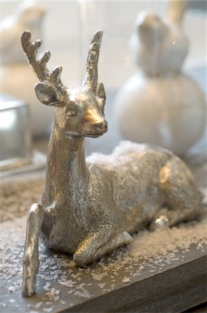 reindeer in snow - Christmas deer figurine Stock Photo - Premium Royalty-Free, Code: 689-05610779