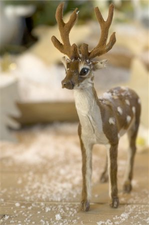 reindeer in snow - Deer figurine and fake snow Stock Photo - Premium Royalty-Free, Code: 689-05610809