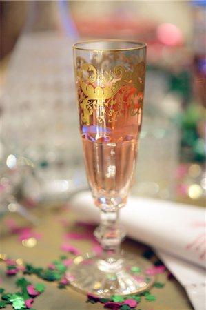 Champagne glass and confetti Stock Photo - Premium Royalty-Free, Code: 689-05610825
