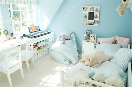 Childrens room with blue walls Stock Photo - Premium Royalty-Free, Code: 689-05610823