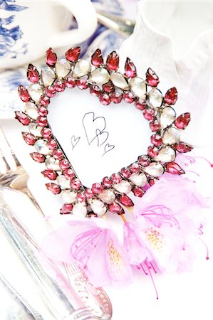 Heart-shaped table decoration Stock Photo - Premium Royalty-Free, Code: 689-05610865
