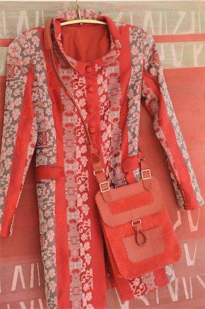 Coat and shoulder bag on coat hanger Stock Photo - Premium Royalty-Free, Code: 689-05610961