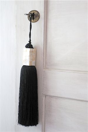 Tassel hanging at closed door Stock Photo - Premium Royalty-Free, Code: 689-05611235