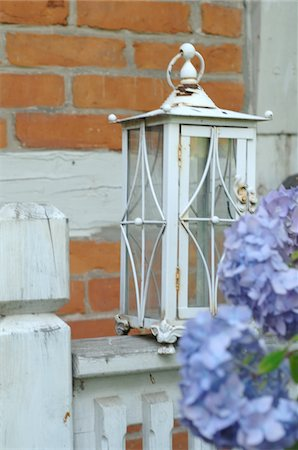 Hydrangea and lantern in front of timber-framed house Stock Photo - Premium Royalty-Free, Code: 689-05611397