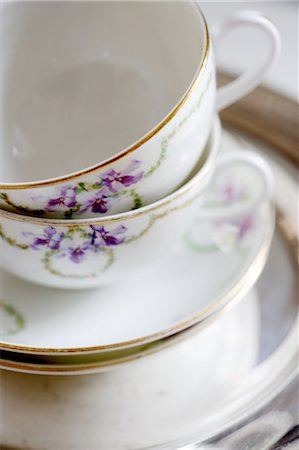Cups with floral pattern und saucers Stock Photo - Premium Royalty-Free, Code: 689-05611455