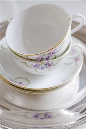 Cups with floral pattern und saucers Stock Photo - Premium Royalty-Free, Code: 689-05611458
