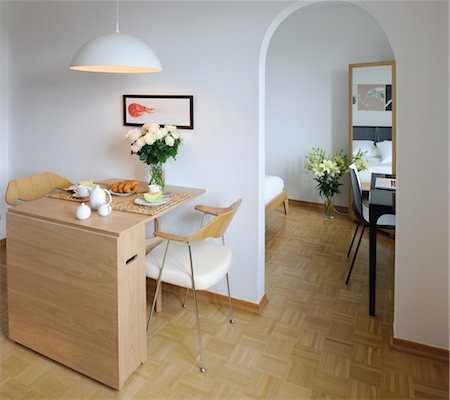 Apartment with dining room and passageway to bedroom Stock Photo - Premium Royalty-Free, Code: 689-05611481