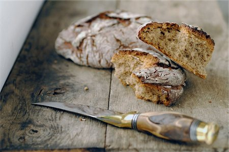 rustic - Bread and kitchen knife Stock Photo - Premium Royalty-Free, Code: 689-05611628