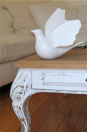 Dove figure on table in living room Stock Photo - Premium Royalty-Free, Code: 689-05611676
