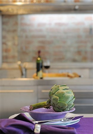 setting kitchen table - Artichoke on plate in kitchen Stock Photo - Premium Royalty-Free, Code: 689-05611774
