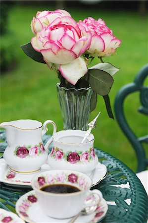 rose patterns - Coffee set and bunch of flowers on garden table Stock Photo - Premium Royalty-Free, Code: 689-05611860