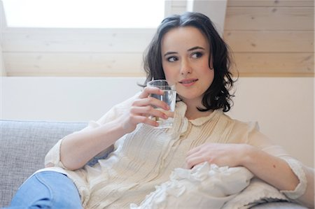 drinking water glass - Young woman on couch drinking glass of water Stock Photo - Premium Royalty-Free, Code: 689-05611947